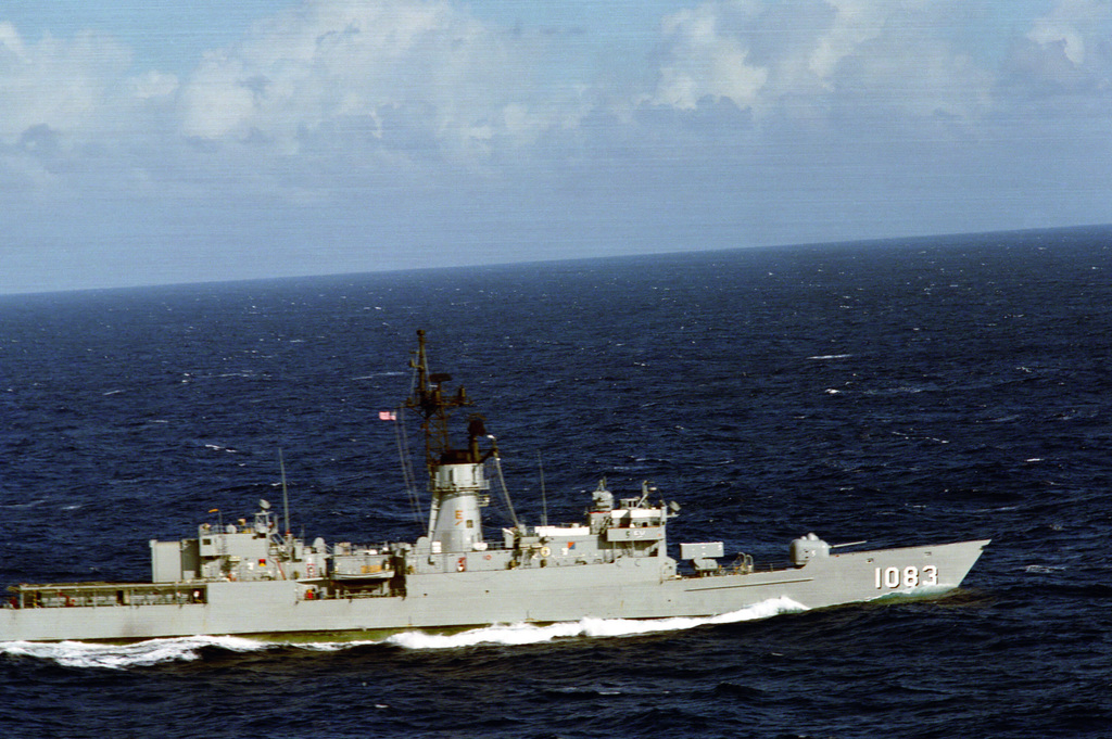 A starboard beam view of the frigate USS COOK (FF 1083) underway. (SUBSTANDARD IMAGE)