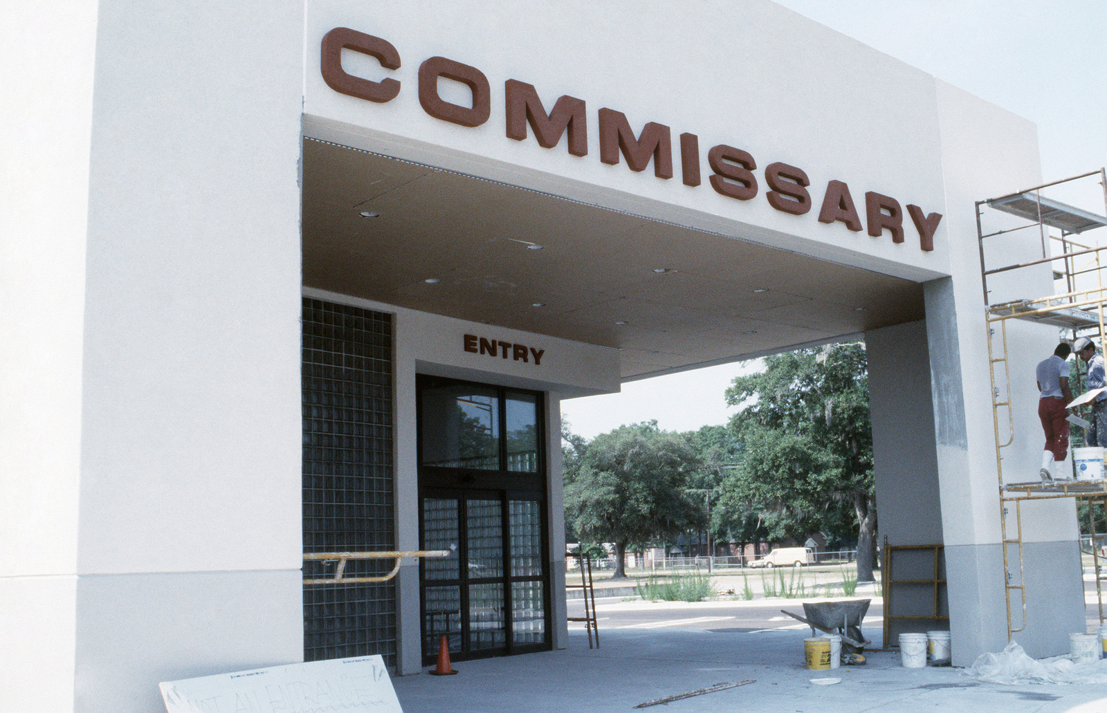 An exterior view of the commissary building under construction