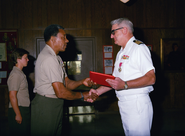 Lieutenant General (LGEN) Frank E. Peterson Jr., commanding general, Marine Corps Development and Educational Center, presents the Meritorious Service Medal to Captain (CAPT) Keyser, USN, Chaplain upon his retirement