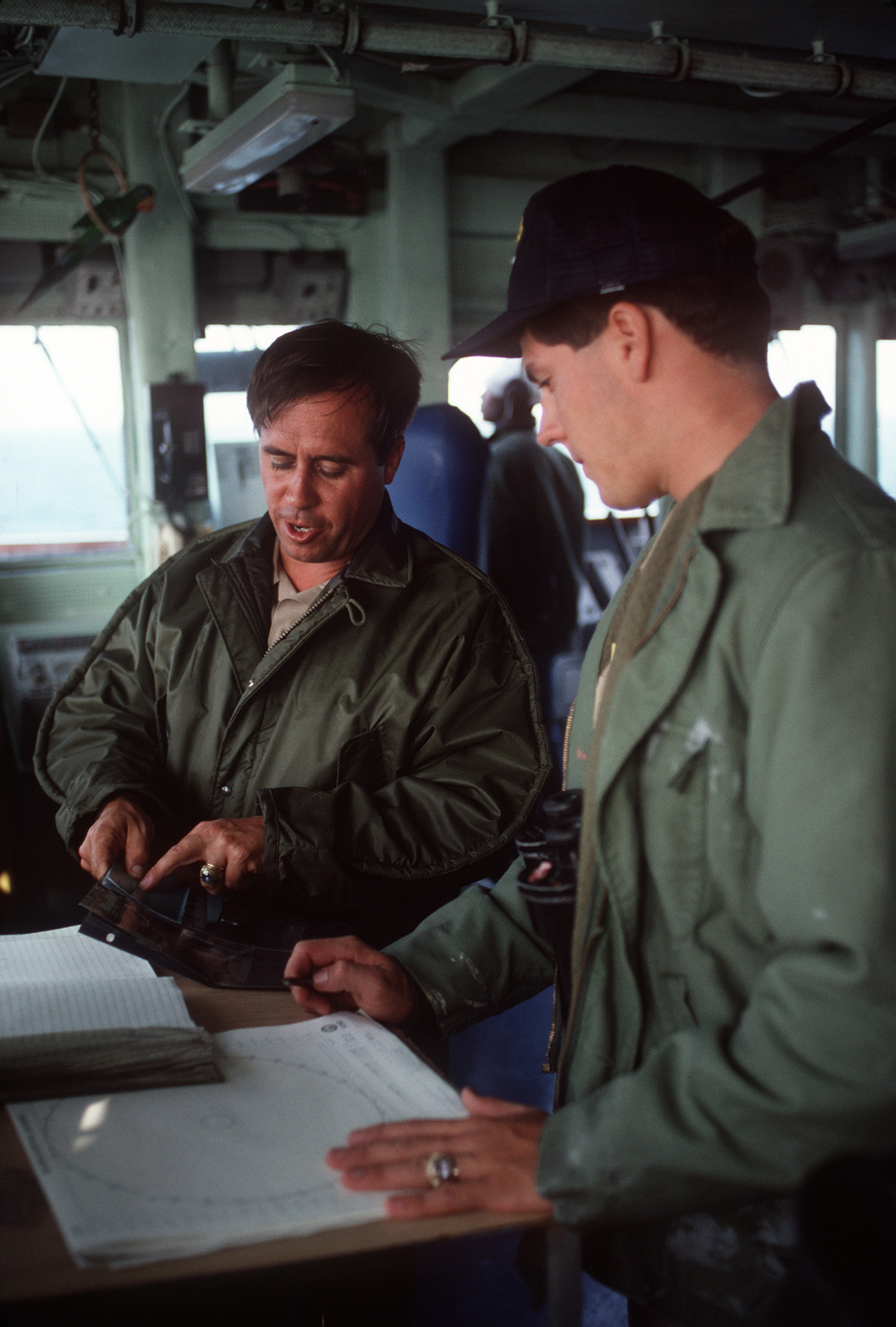 A midshipman acts as junior officer of the deck during a