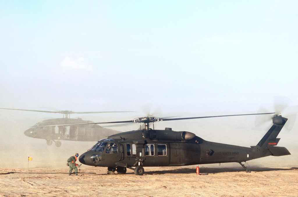 A UH-60A Black Hawk (Blackhawk) helicopter is refueled during Exercise GALLANT EAGLE '86