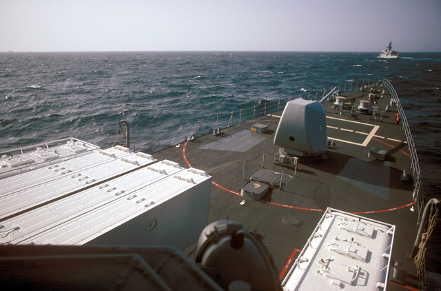 A view from the bridge of the destroyer USS LEFTWICH (DD 984) while the ship is underway during a midshipmen's summer training cruise. The ship is equipped with Tomahawk armored box launchers on each side of the Mark 16 anti-submarine rocket (ASROC) launcher, foreground, and a Mark 45 5-inch/54-cal