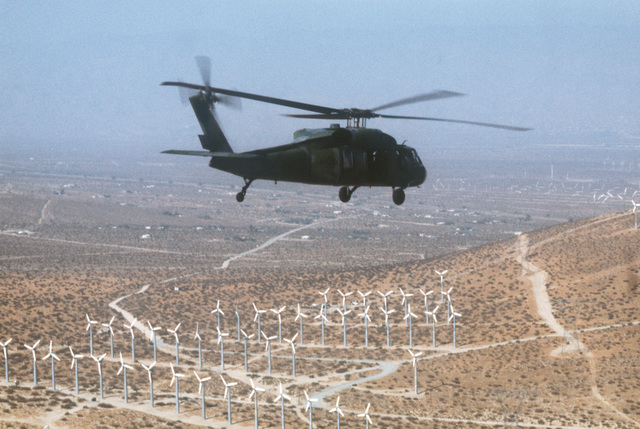 Air to air right rear viw of a 55th Aerospace Rescue and Recovery Squadron UH-60A Black Hawk (Blackhawk) helicopter. The helicopter is participating in Exercise GALLANT EAGLE '86