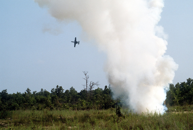 An A-10A Thunderbolt II aircraft maneuvers away from the launch site of a GTR-18A Smokey Sam training missile