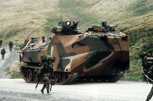 An AAVP-7 amphibious assault vehicle of Company C, 1ST Amtrac Battalion moves along a road during amphibious Exercise Kernel Potlatch 86-1. The vehicle is attached to the 1ST Battalion, 2nd Marine Regiment for the exercise