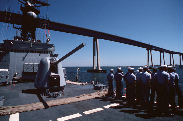 Crew members stand by in front of forward Mark 45 5-inch/54-cal. gun during deck drills aboard the destroyer USS LEFTWICH (DD 984)