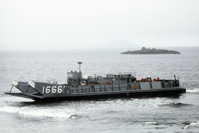 Members of the 1ST Battalion, 2nd Marine Regiment, come ashore in the utility landing craft LCU 1666 during amphibious Exercise KERNEL POTLATCH 86-1