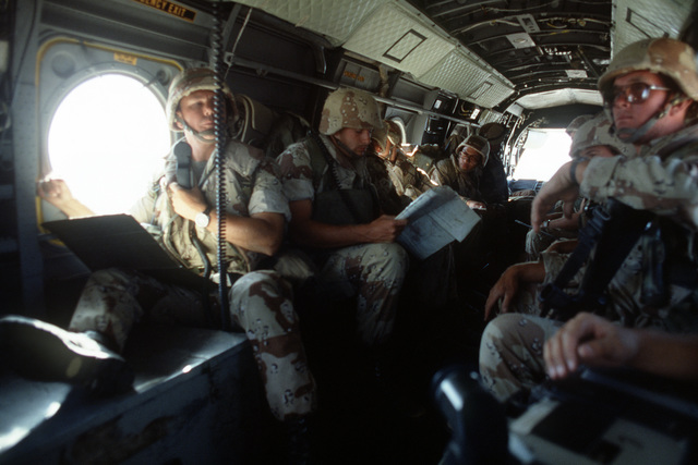 Members of the 27th Marine Regiment are transported to a landing zone aboard a Marine Medium Helicopter Squadron 164 (HMM-164) CH-46E Sea Knight helicopter. The Marines are participating in exercise Gallant Eagle '86