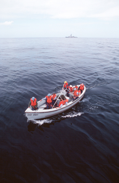 Midshipmen and crew members from the destroyer USS LEFTWICH (DD 984) operate a Mark 10 motor whaleboat while participating in a man-overboard drill during a midshipmen's summer training cruise