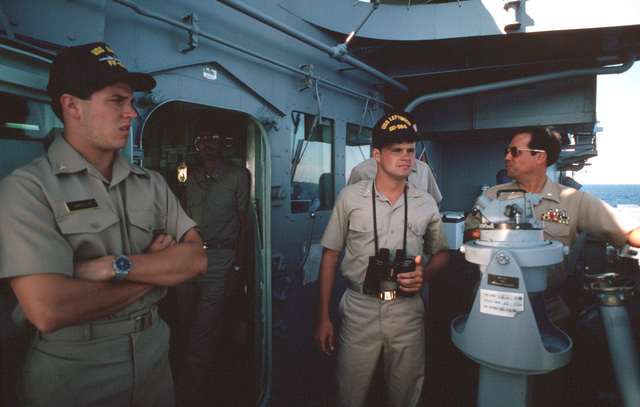 Midshipmen stand watch aboard the destroyer USS LEFTWICH (DD 984) during a midshipmen's summer training cruise