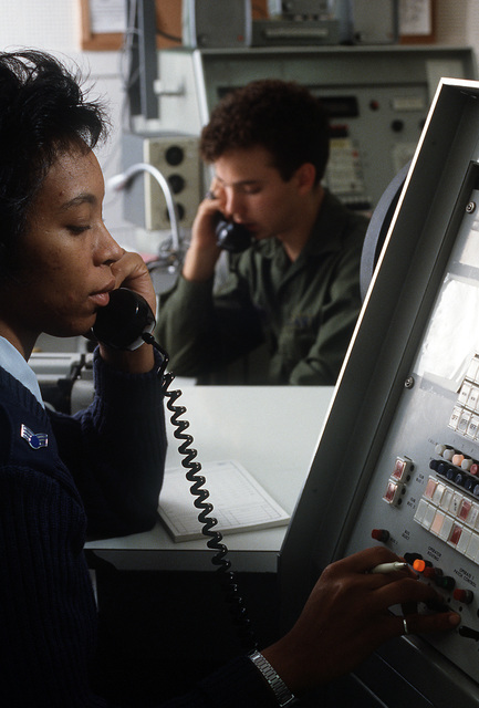 SENIOR AIRMAN Vernetta Brown and SENIOR AIRMAN Brian Zimmerman, information systems radio operators with the 1930th Information Systems Squadron, operate scope pattern consoles on the global command and control system. The system provides communication between ground support and all DOD/civilian aircraft in the Pacific region
