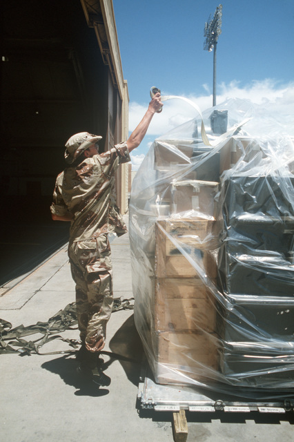 Sergeant (SGT) Gary C. Oaks 347th Equipment Maintenance Squadron, releases the bindings on a pallet of equipment and supplies during Exercise GALLANT EAGLE '86