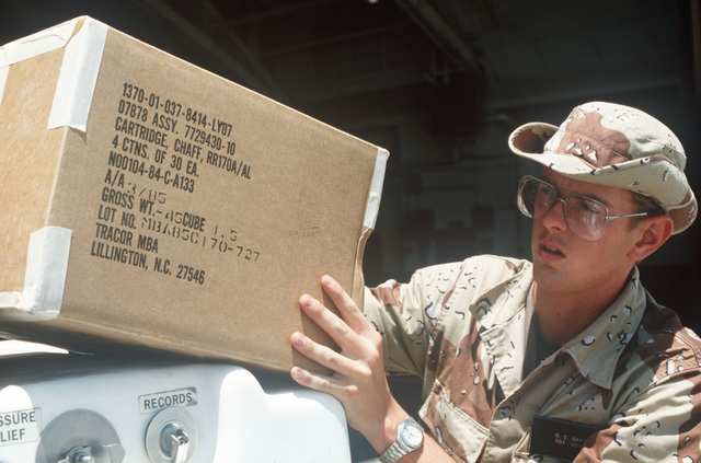 Sergeant (SGT) Gary C. Oaks 347th Equipment Maintenance Squadron, unloads a box of chaff cartridges during Exercise GALLANT EAGLE '86