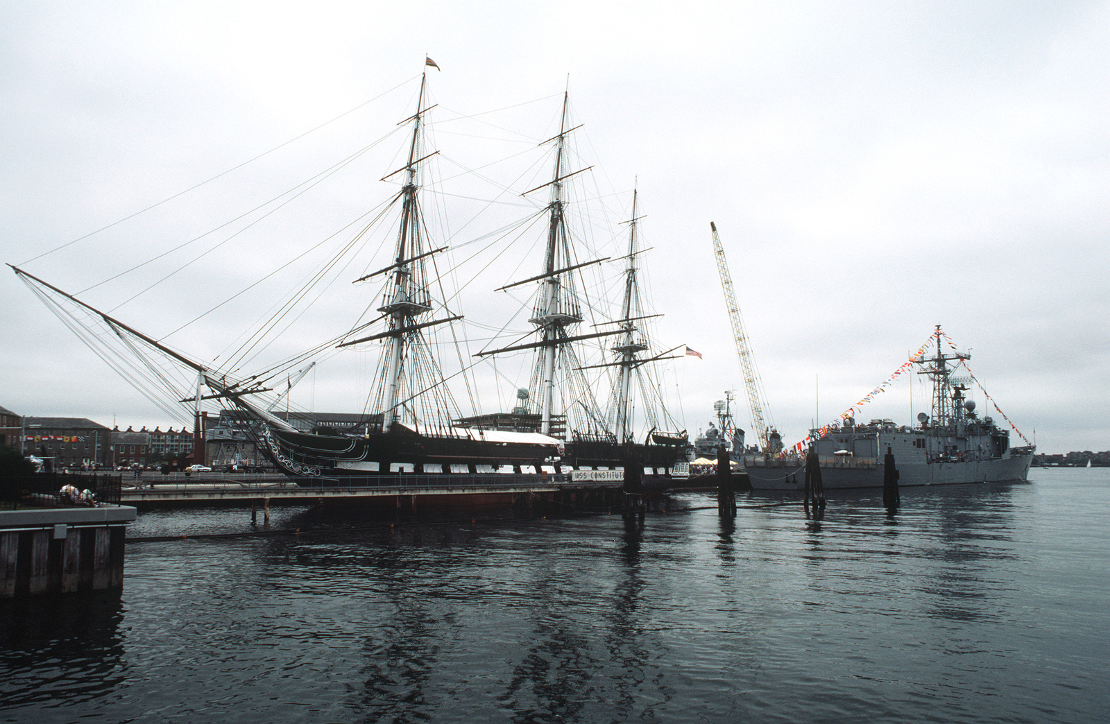 A port bow view of the 44-gun sail frigate USS CONSTITUTION tied up at its berth at the Charlestown Navy Yard