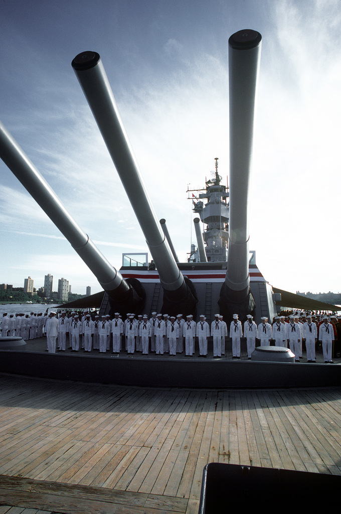 A special presidential honors detail stands in formation around turret No. 1 aboard the battleship USS IOWA (BB-61) during the International Naval Review. A security platform for President and Mrs. Ronald Reagan is on top of the turret