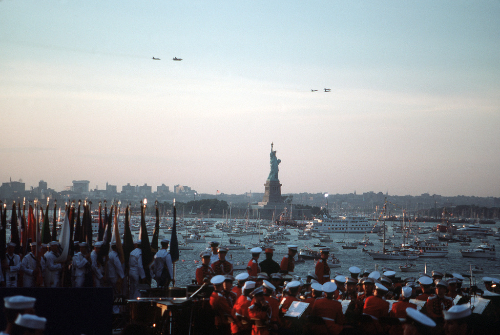 A view from the aircraft carrier USS JOHN F. KENNEDY (CV 67) of the Statue of Liberty and the boat-filled harbor during the 100th anniversary celebration