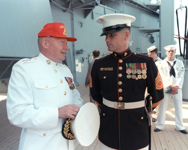 Lieutenant General (LGEN) Alfred M. Gray, commanding officer, Fleet Marine Force, Atlantic, left, talks with GUNNERY Sergeant (GYSGT) Ronald Kirby of the Marine detachment aboard the battleship USS IOWA (BB 61) during the International Naval Review in the harbor. The IOWA is serving as the flagship and reviewing ship for the festivities