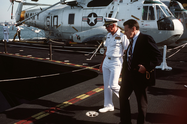 Secretary of Defense Caspar W. Weinberger and US Navy (USN) Captain (CAPT) John A. Moriarty, commanding officer of the aircraft carrier USS JOHN F. KENNEDY (CV 67), tour the ship during the International Naval Review celebrating the centennial of the Statue of Liberty