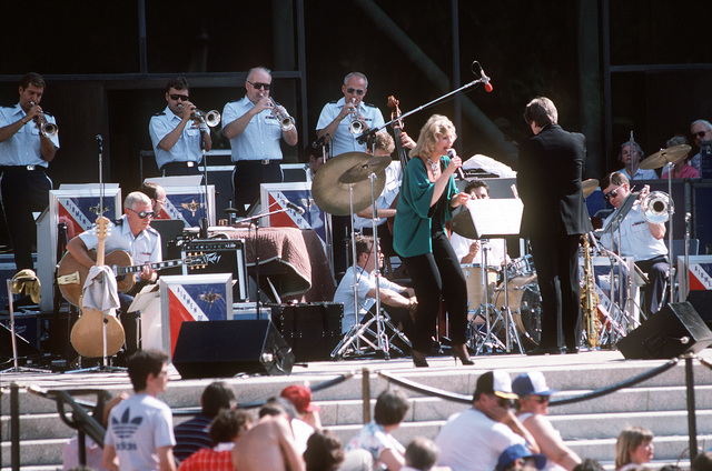 Tony Tennille performs with the Airmen of Note, a U.S. Air Force band, during a Fourth of July show outside the National Air and Space Museum