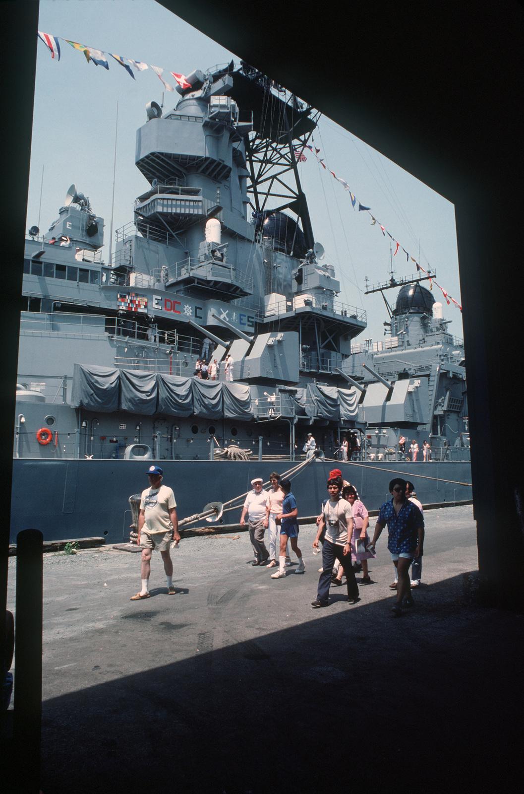 Tourists visit aboard the battleship USS IOWA (BB 61) during