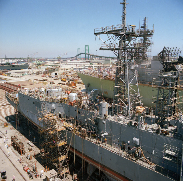 A starboard view of the aft section of the guided missile frigate USS RODNEY M. DAVIS (FFG 60). The ship is at 80 percent completion at the Todd shipyard