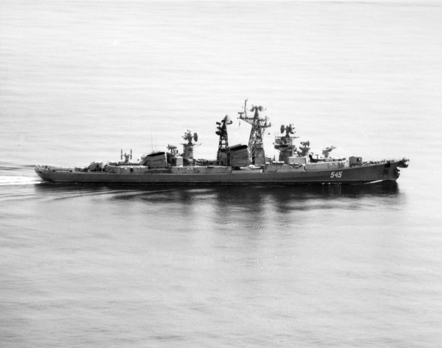 A starboard beam view of the Soviet Kashin class guided missile destroyer STROGIY showing bow damage resulting from a collision with the Kara class guided missile cruiser NIKOLAYEV