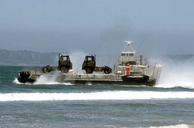 A US Army LACV-30 (Lighter Air Cushion Vehicle - 30 Ton) hovercraft transports ground support equipment to shore during Exercise GALLANT EAGLE '86