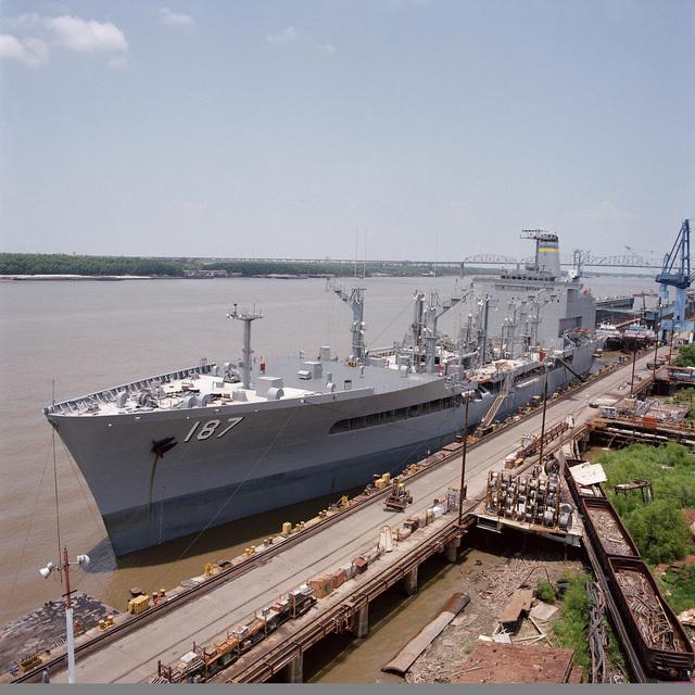 A port bow view of the fleet oiler USNS HENRY J. KAISER (T-AO 187) moored at the Avondale Industries, Inc. shipyard.  The ship is 90 percent complete