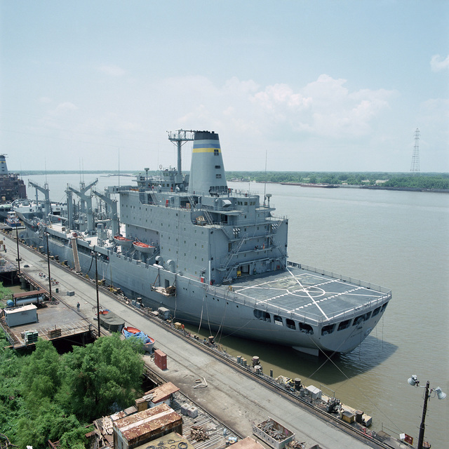 A port quarter view of the fleet oiler USNS HENRY J. KAISER (T-AO 187) moored at the Avondale Industries, Inc. shipyard.  The ship is 90 percent complete