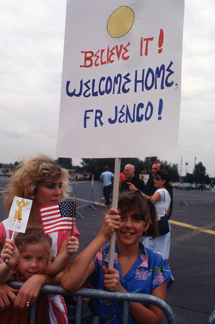 Well-wishers display a welcome home sign as they await the arrival of the Reverend Lawrence Jenco.  Father Jenco a Roman Catholic priest, was recently freed after 19 months of captivity in Lebanon