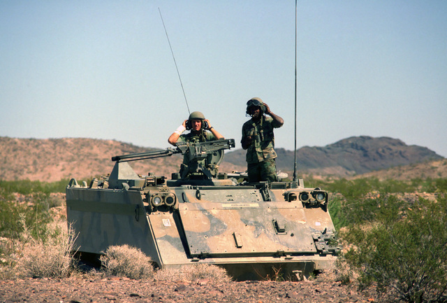 Members of the 197th Infantry Brigade (Mechanized) look out from the top of an M113A1 armored personnel carrier during Exercise GALLANT EAGLE '86