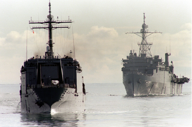 A bow view of the tank landing ship USS SPARTANBURG COUNTY (LST-1192) and the amphibious transport dock ship USS NASHWILLE (LPD-13) participating in operation Northern Wedding