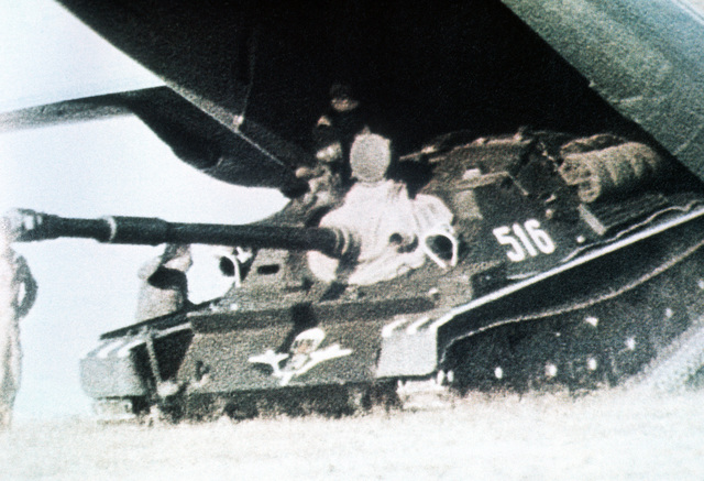 A Soviet ASU-85 self-propelled anti-tank gun is unloaded from an An-12 Cub aircraft. Exact Date Shot Unknown