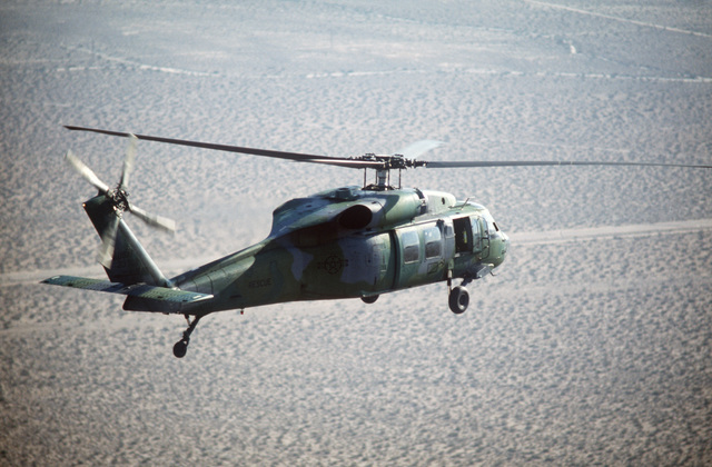 An air to air right rear view of an Air Force UH-60A Black Hawk (Blackhawk) helicopter of the 55th Aerospace Rescue and Recovery Squadron during Exercise GALLANT EAGLE '86