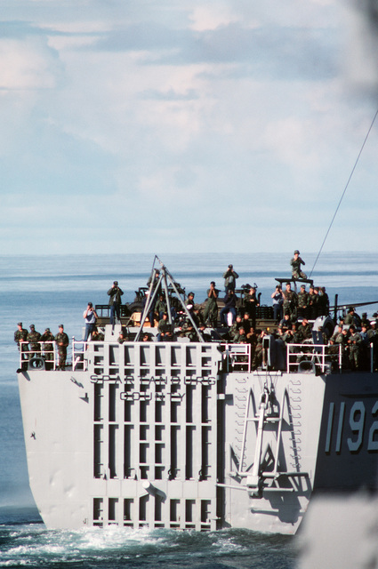 North Atlantic Ocean. Crew members aboard the tank landing ship USS SPARTANBURG COUNTY (LST 1192) gather on the fantail for a view of the battleship USS IOWA (BB 61) during NATO Exercise NORTHERN WEDDING 86