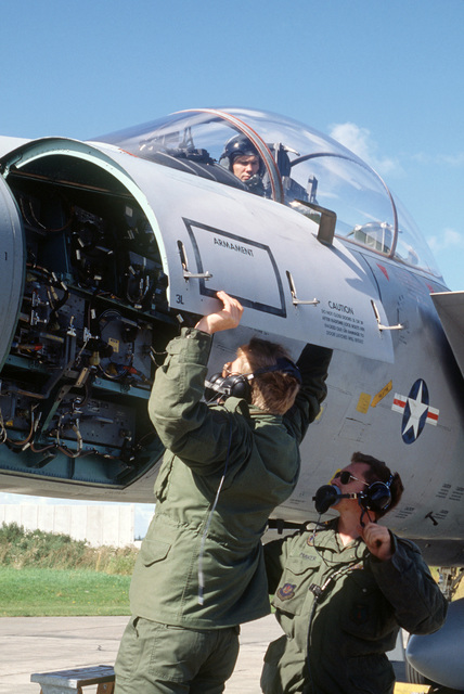Staff Sergeants (SSGT) John Howerton and Jeff Maker, 36th Tactical Fighter Wing ground crew members, lift the forward panel of an F-15C Eagle aircraft to check a radar processor during Exercise OKSBOEL '86