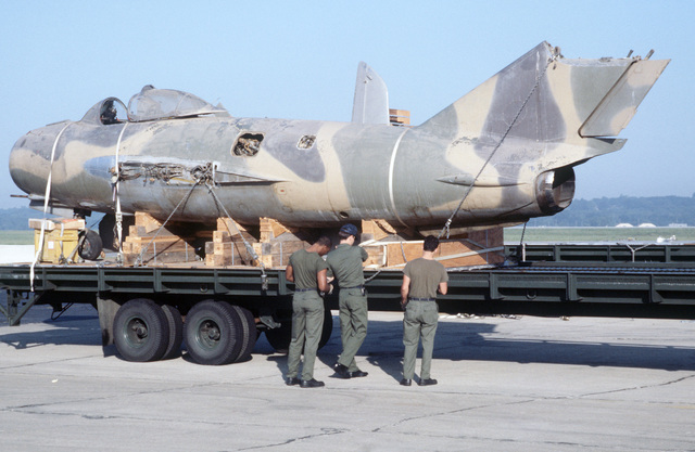 A MiG-17 Fresco aircraft is readied for transport to the US Air Force Museum