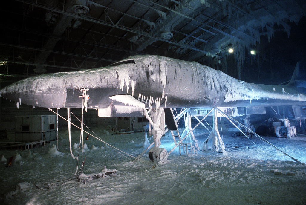 An ice and snow-covered B-1B aircraft undergoes simulated arctic weather conditions during environmental testing in the main chamber of the McKinley Climatic Laboratory. Each of the aircraft's 15 major systems will be tested by extremely hot and cold temperatures while in the chamber. The laboratory is part of the 3246th Test Wing and the Air Force Armament Division