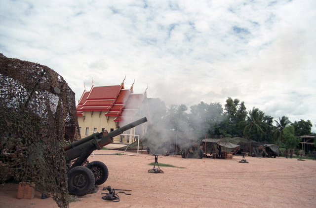 An M102 105 mm Howitzer from Battery C, 7th Battalion, 8th Field Artillery Regiment, 25th Division Artillery, 25th Infantry Divison (Light), is fired from under a Ban Khai area during the joint US/Thai training Exercise COBRA GOLD '86
