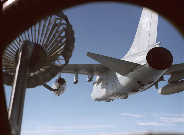 An Attack Squadron 82 (VA-82) A-7E Corsair II aircraft refuels an A-6E Intruder aircraft in flight