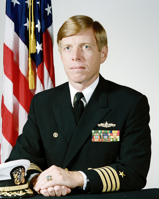 Portrait:  US Navy (USN) Captain (CAPT) Thomas M. Daly (uncovered)