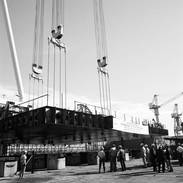 A section of the keel is lowered onto blocks at the Newport News Shipbuilding shipyard during the keel laying of the nuclear-powered aircraft carrier USS GEORGE WASHINGTON (CVN 73)