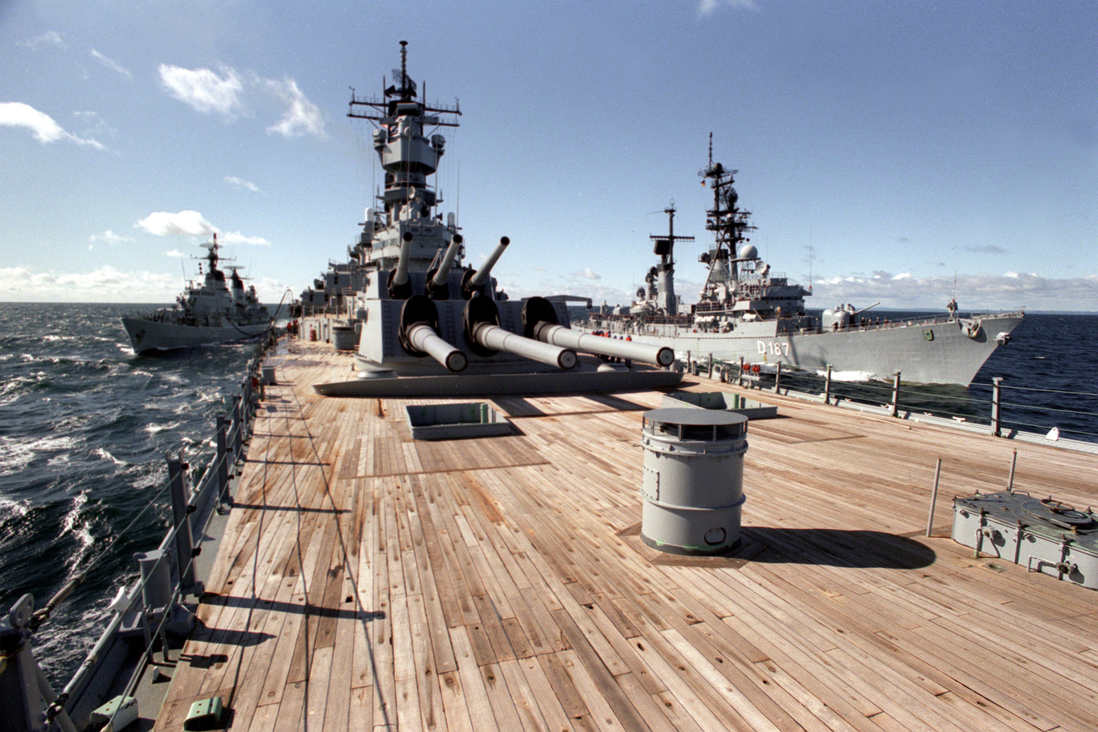 The battleship USS IOWA (BB-61) refuels the German destroyer FGS ROMMEL (D-187) on the port side and the Dutch frigate HDMS PEDER SKRAM (F-352) on the starboard side during operation Northern Wedding. This is the first time the IOWA has provided simultaneous services to two ships since her third commissioning in 1984