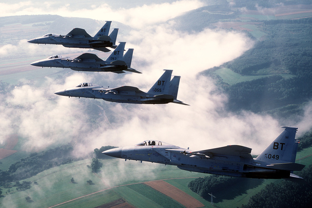 An air-to-air left side view of a formation of four 36th Tactical Fighter Wing F-15C Eagle aircraft armed with AIM-9 Sidewinder missiles. In October, this team of Eagles will be deployed to Tyndall AFB, Fla., to compete in Exercise William Tell '86