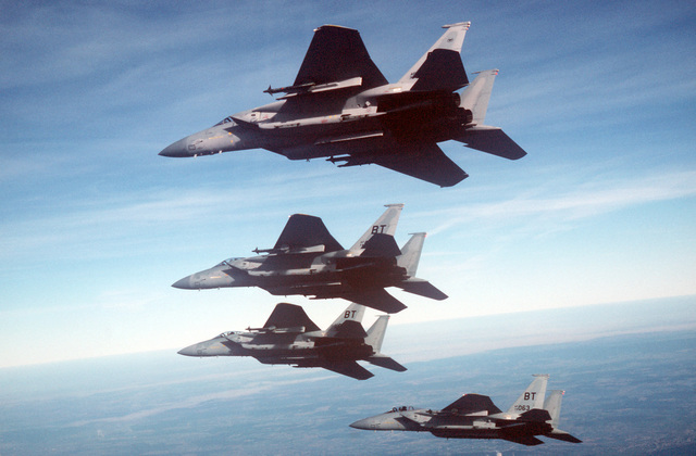 An air-to-air left underside view of a formation of four 36th Tactical Fighter Wing F-15C Eagle aircraft armed with AIM-9 Sidewinder missiles. In October, this team of Eagles will be deployed to Tyndall Air Force Base, Florida, to compete in Exercise WILLIAM TELL '86