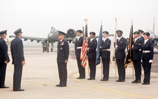 Colonel (COL) James L. Altemose stands at attention in front of a color guard facing General Robert W. Bazley, commander, Pacific Air Forces, right, and Major General (MGEN) James T. Callaghan, commander, Republic of Korea/US Combined Forces Command, left. The officers are participating in a ceremony marking the deactivation of the 314th Air Division and the reactivation of the 7th Air Force