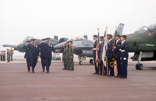 Flight crews and a color guard salute as they are reviewed by General (GEN) Robert W. Bazley, commander, Pacific Air Forces, during ceremonies marking the deactivation of the 314th Air Division and the reactivation of the 7th Air Force. With Bazley are Colonel (COL) James L. Altemose, Major General (MGEN) James T. Callaghan, commander, Republic of Korea/US Combined Forces Command and Lieutenant General (LGEN) Jack I. Gregory, new commander, 7th Air Force