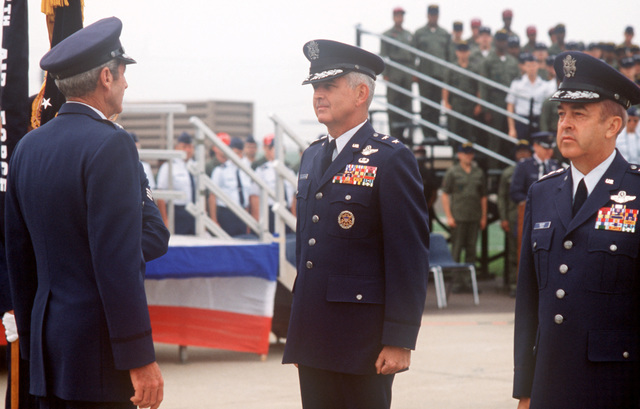 Major General (MGEN) James T. Callaghan, commander, Republic of Korea/US Combined Forces Command, and Lieutenant General (LGEN) Jack I. Gregory, new commander, 7th Air Force, stand at attention facing General (GEN) Robert W. Bazley, commander, Pacific Air Forces, during ceremonies marking the deactivation of the 314th Air Division and the reactivation of the 7th Air Force