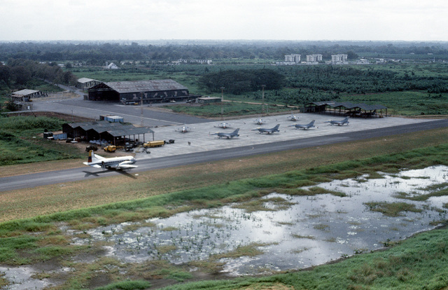 Eight F-16A Fighting Falcon aircraft from the 388th Tactical Fighter Wing sit on the flight line near an Ecuadoran air force BAe 748 military transport aircraft during the joint Ecuadoran/U.S. exercise Blue Horizon '86