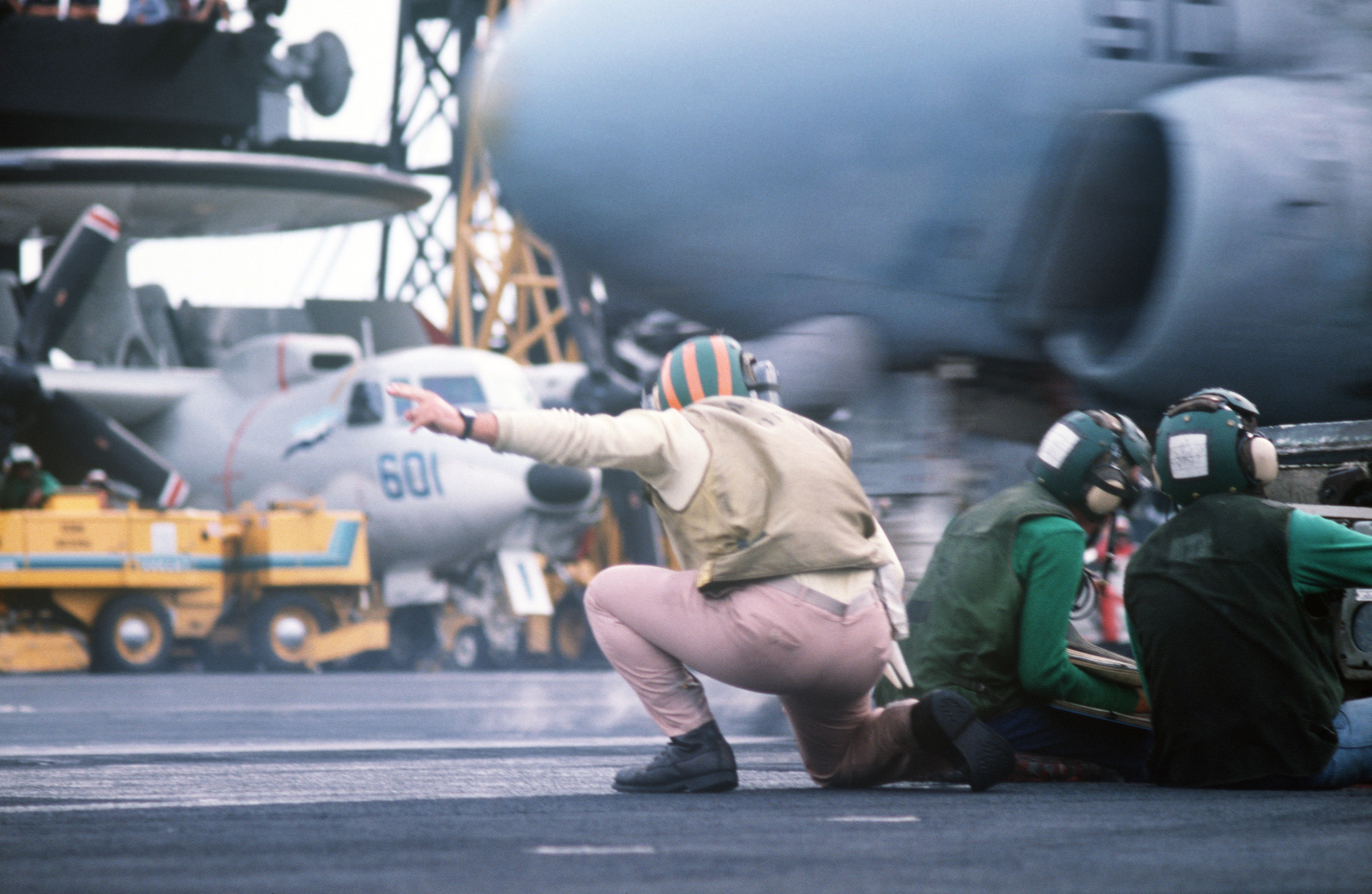A catapult officer gives the launch signal to the pilot of an A-6E Intruder aircraft aboard the aircraft carrier USS JOHN F. KENNEDY (CV 67) during NATO Exercise DISPLAY DETERMINATION '86